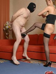 Mistress beats, kicks and bites her masked boy toy's useless little balls